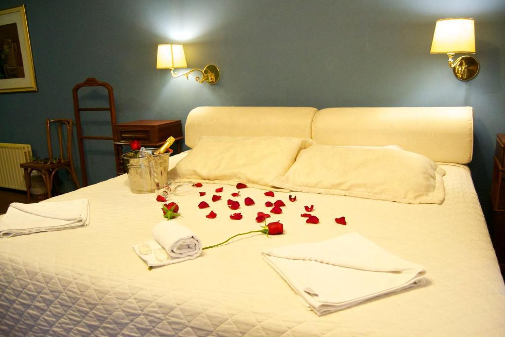 Cama ou camas em um quarto em Pousada Casa Rosa