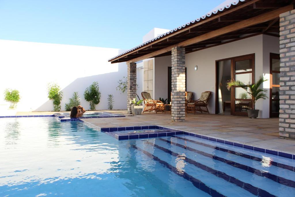 Casa de temporada casa moderna de praia brasil touros for Casa moderna piscina