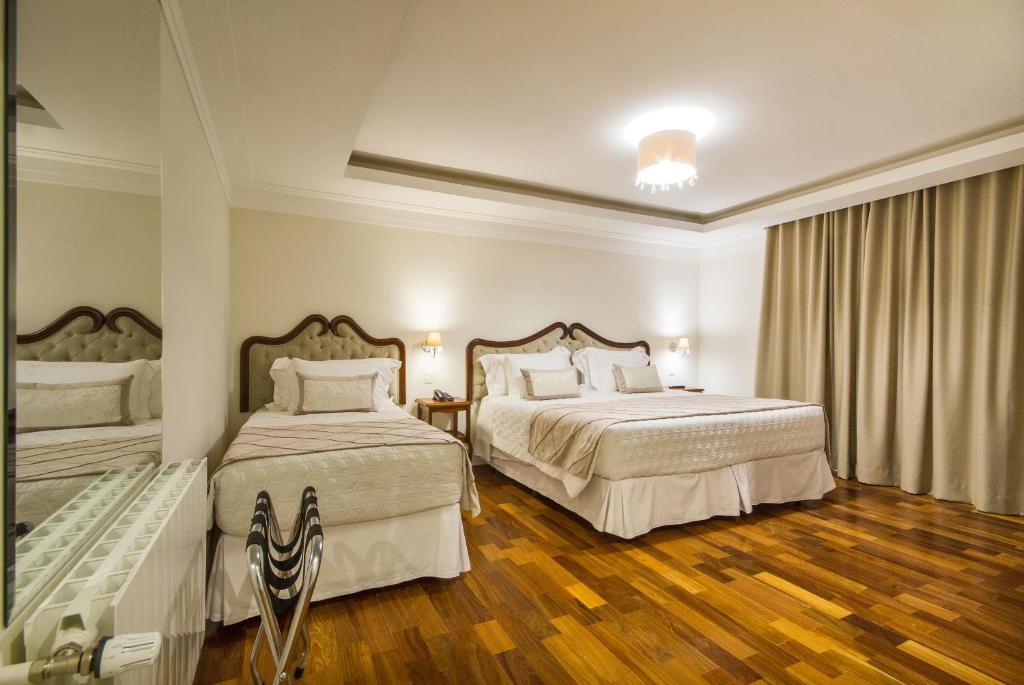 Cama ou camas em um quarto em Hotel Estoril