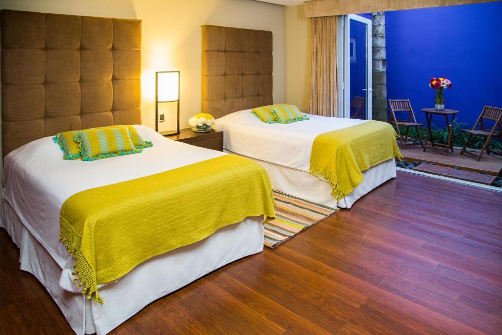מיטה או מיטות בחדר ב-Apart-Hotel Casa Serena