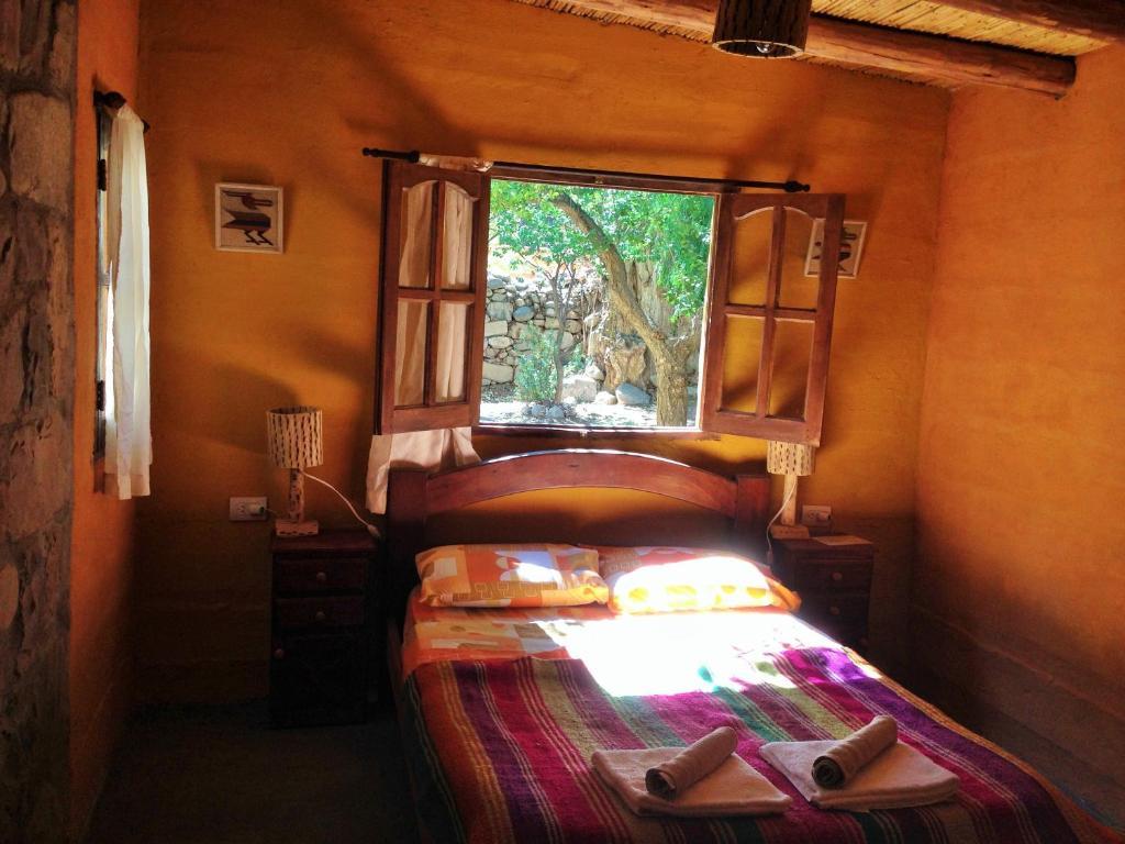 Una cama o camas en una habitación de La Nochera