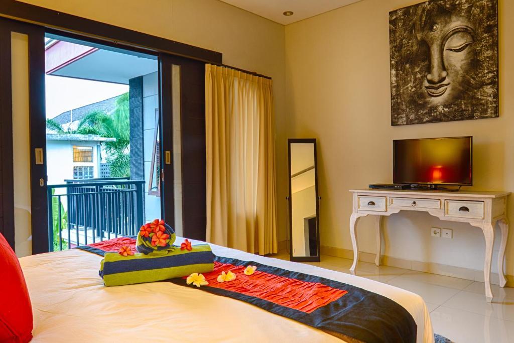 Cama ou camas em um quarto em Agung Rakas
