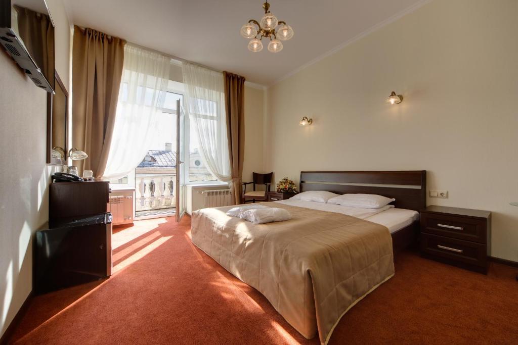 Cama ou camas em um quarto em Solo Admiralteyskaya