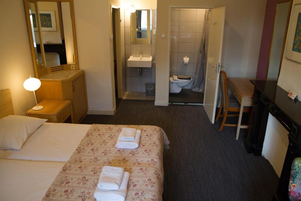 Cama ou camas em um quarto em Hotel Verdi