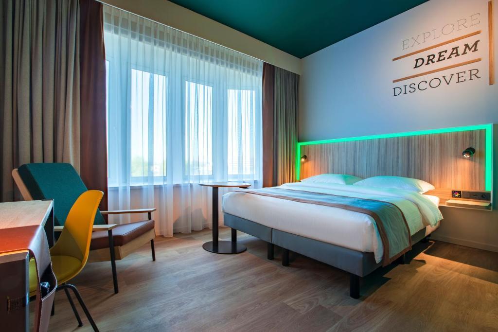 מיטה או מיטות בחדר ב-Park Inn By Radisson Brussels Airport