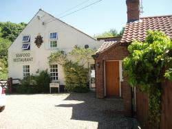The Old Forge Seafood Restaurant and Bed and Breakfast, Fakenham Road, Thursford, Norfolk, England, NR21 0BD, Thursford