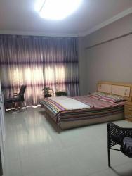 Warm Family Apartment, Jiajiafu Supermarket, Tianzheng International Square, Tianhe Bay, Fengcheng City., 118108, Fengcheng