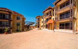 KCE Suites, PLOT 2023 BLOCK 220, MICHEAL KAGGWA ROAD,, Buwate
