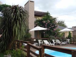 """Luna de Artalaz Apartments, Madres y Abuelas de Pza de Mayo y Profesor Velazco, GPS: S 32 º 12 ' 50.9 """" W: 58 º 9 ' 37.2 """", 3280, Colón"""