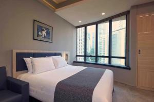 Cama ou camas em um quarto em Orchard Grand Court