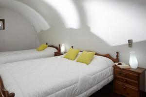 מיטה או מיטות בחדר ב-Anna Traditional Apartments