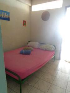 Cama ou camas em um quarto em Apartamento Santo Antonio vista da bahia