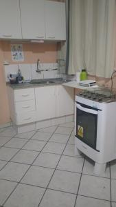 A cozinha ou cozinha compacta de Home Sweet Home