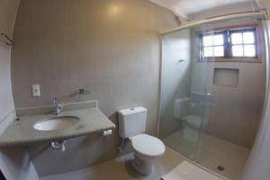 Um banheiro em Flat Vila Morena