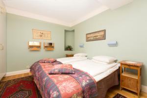 מיטה או מיטות בחדר ב-Lady Hamilton Apartments