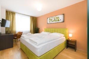 מיטה או מיטות בחדר ב-Vienna Stay Apartments Tabor 1020