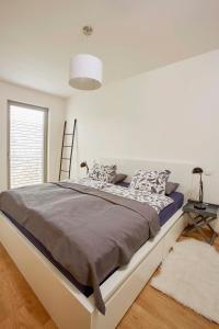 Cama ou camas em um quarto em Modern Apartment
