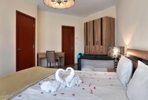 Una cama o camas en una habitación de Apart Hotel Golden Line