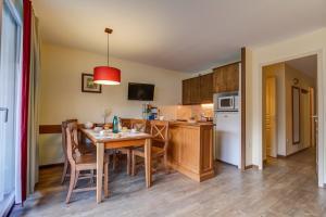 مطبخ أو مطبخ صغير في Résidence Pierre & Vacances Les Trois Domaines