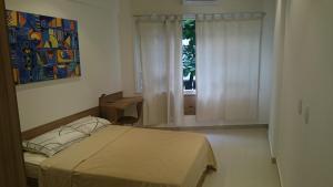 Giường trong phòng chung tại #111 - Domingos Beach Pad