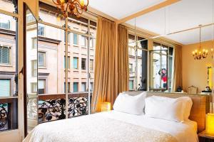 מיטה או מיטות בחדר ב-Glamour Apartments