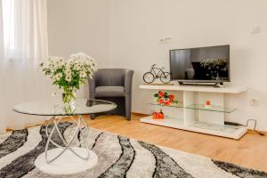 Khu vực ghế ngồi tại LCT Holiday Home Florentina