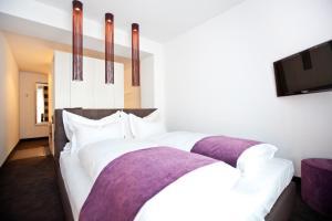 سرير أو أسرّة في غرفة في غودمانز ليفينغ