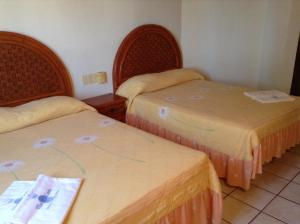 Hoteles en los ayala reserva ahora tu hotel for Hotel villas corona en los ayala nayarit