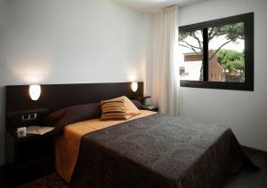 מיטה או מיטות בחדר ב-SG Marina 54 Apartments