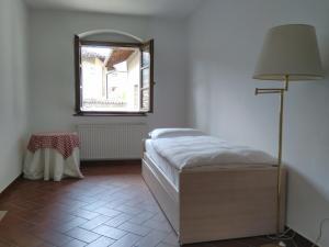 Cama ou camas em um quarto em La Corte del Conte