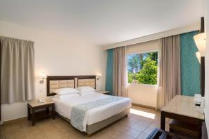 מיטה או מיטות בחדר ב-Avanti Holiday Village