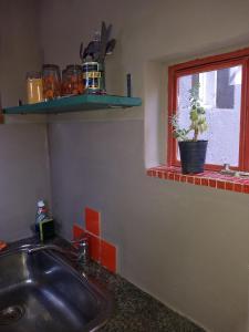 Una cocina o kitchenette en El Tamarisco