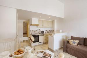 A cozinha ou cozinha compacta de Résidence Prestige Odalys La Bastide des Chênes