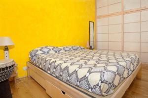 Giường trong phòng chung tại Casa d'artista