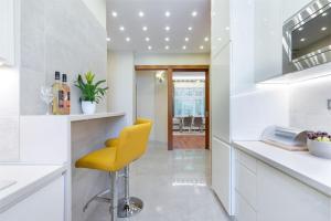 مطبخ أو مطبخ صغير في CityPark Deluxe Apartment