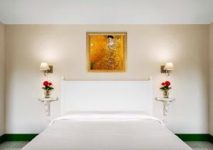 Giường trong phòng chung tại La Dimora