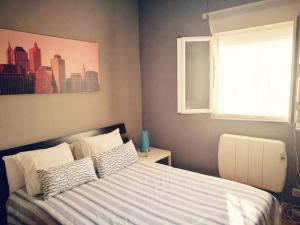 מיטה או מיטות בחדר ב-Apartamento Urgel