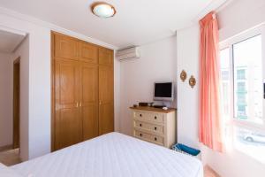 Giường trong phòng chung tại Apartment El Drac