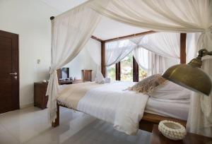 Cama ou camas em um quarto em Evelina
