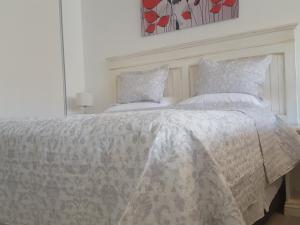 Cama ou camas em um quarto em Cerca de Todo ARG