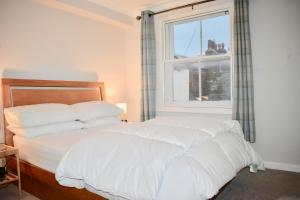 Cama ou camas em um quarto em 1 Bedroom Central Flat
