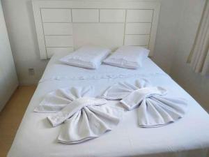 Cama ou camas em um quarto em Flat Vinhedos Charme