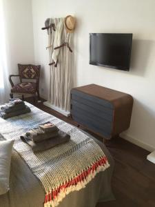 Uma TV ou centro de entretenimento em Appartement moderne 4p hypercentre de nice