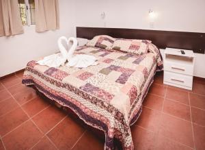 Una cama o camas en una habitación de Apart Hotel La Candida