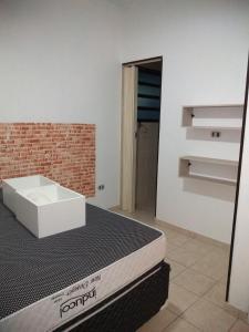 Um banheiro em Apartamento São Vicente