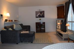 אזור ישיבה ב-Modern and Homely 2 Bed Flat in Whitechapel
