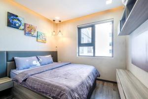 Giường trong phòng chung tại Apartments Sea View