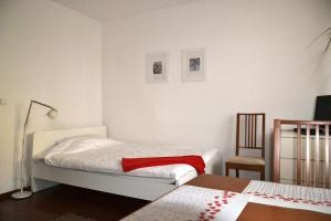 Giường trong phòng chung tại Great Apart Kabaty