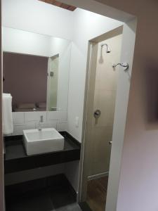 Um banheiro em Flat Coqueiros