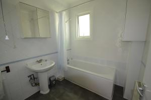 حمام في Central Comfort Apartments